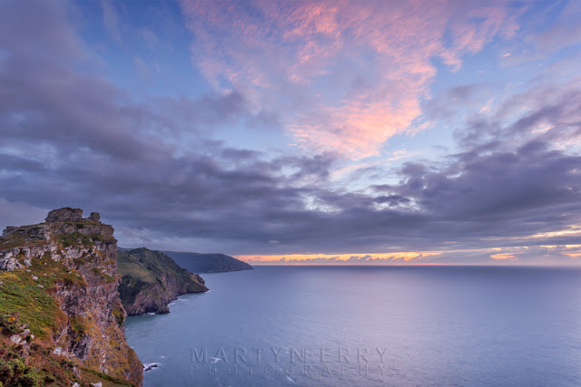 Pink clouds over Castle Rock at the Valley of Rocks in Exmoor by Martyn Ferry Photography