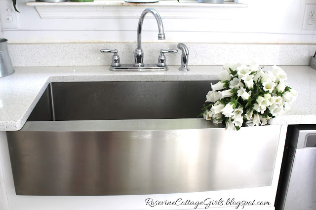 Beautiful farmhouse sink with flowers by rosevine cottage girls