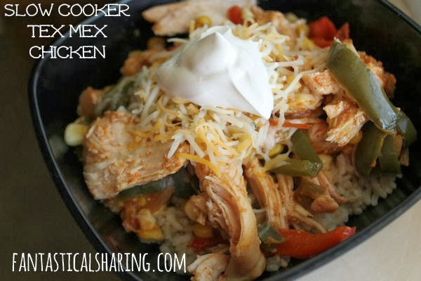 Slow Cooker Tex Mex Chicken // This Tex Mex chicken is perfect to top some rice or roll up in a tortilla. #recipe #chicken #slowcooker #texmex