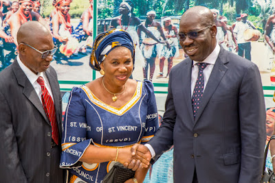 Governor Obaseki in a handshake with Mrs Betsy Onojah of the Society of St. Vincent De Paul