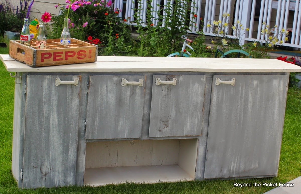 old kitchen cupboard turned storage counter and bar http://bec4-beyondthepicketfence.blogspot.com/2014/06/1-old-cupboardreclaimed-wood2-cut-colors.html