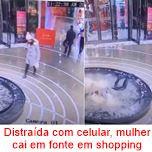 Distraída com celular, mulher cai em fonte em shopping