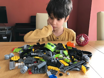 Child taking part in a Lego building challenge
