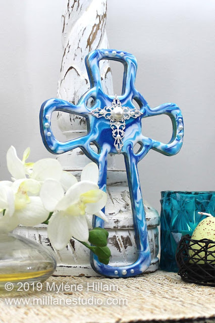 Marbled blue resin cross with filigree and acrylic pearls for decoration