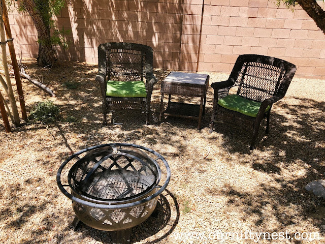 budget backyard refresh table, chairs and fire pit close up