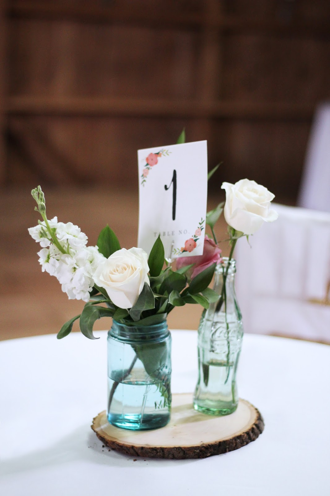 Wedding part one flowers centerpieces a classy fashionista the centerpieces were a mason jar a vintage coke bottle my mom picked these up a few years ago at a yard sale and a small vase i borrowed these from my reviewsmspy