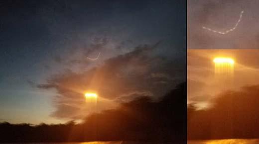 Captan brillantes esferas arriba y rayos de luz debajo de nube sobre el río Missouri, EE.UU.