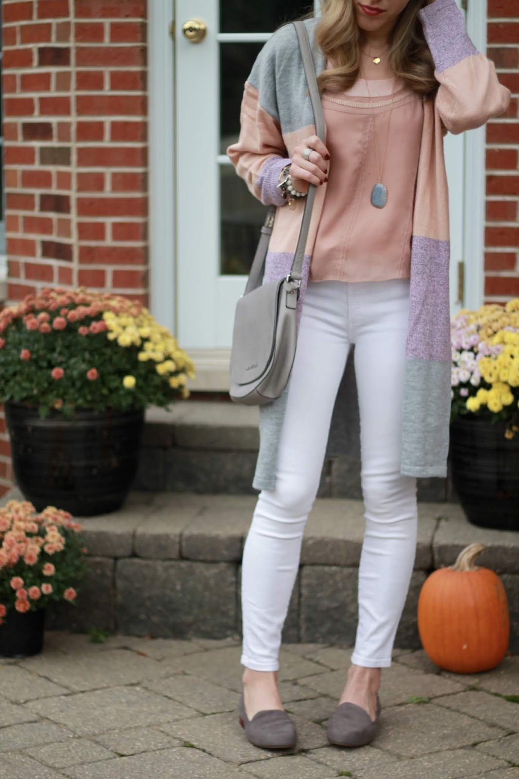 blush top, blush grey striped cardigan, white denim, grey saddlebag, grey loafers