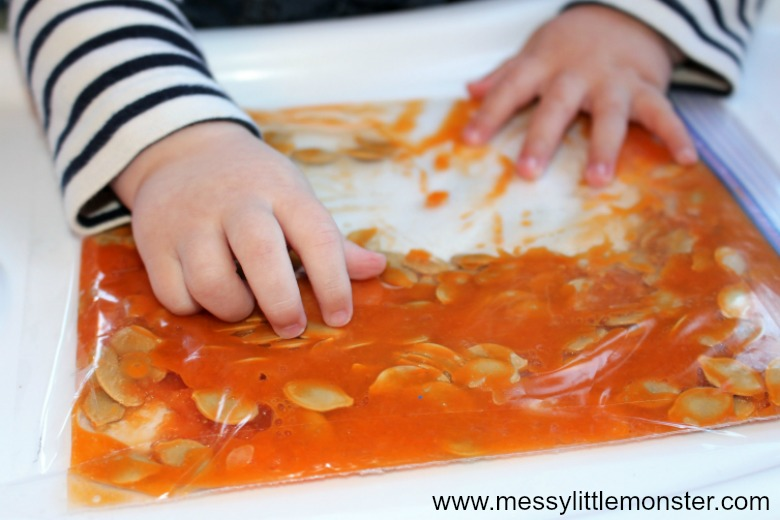 Making a pumpkin sensory bag is a fun and easy way to engage in sensory play for babies!