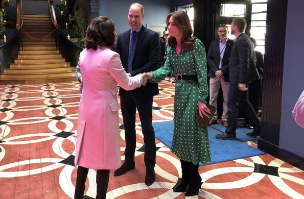 Kate Middleton wore a green midi dress by Suzannah. Alexander McQueen khaki long coat and Jimmy Choo boots