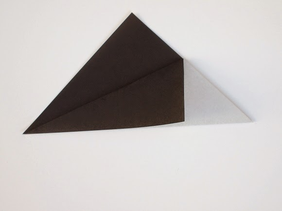 fold down top corner of the triangle