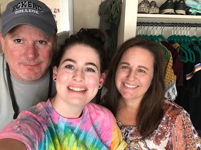 This is a photo of Jessica with her husband and daughter, when Jessica was dropping her daughter off for her first semester of college.