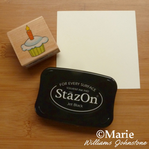Rubber stamp, ink and paper to start stamping paper craft