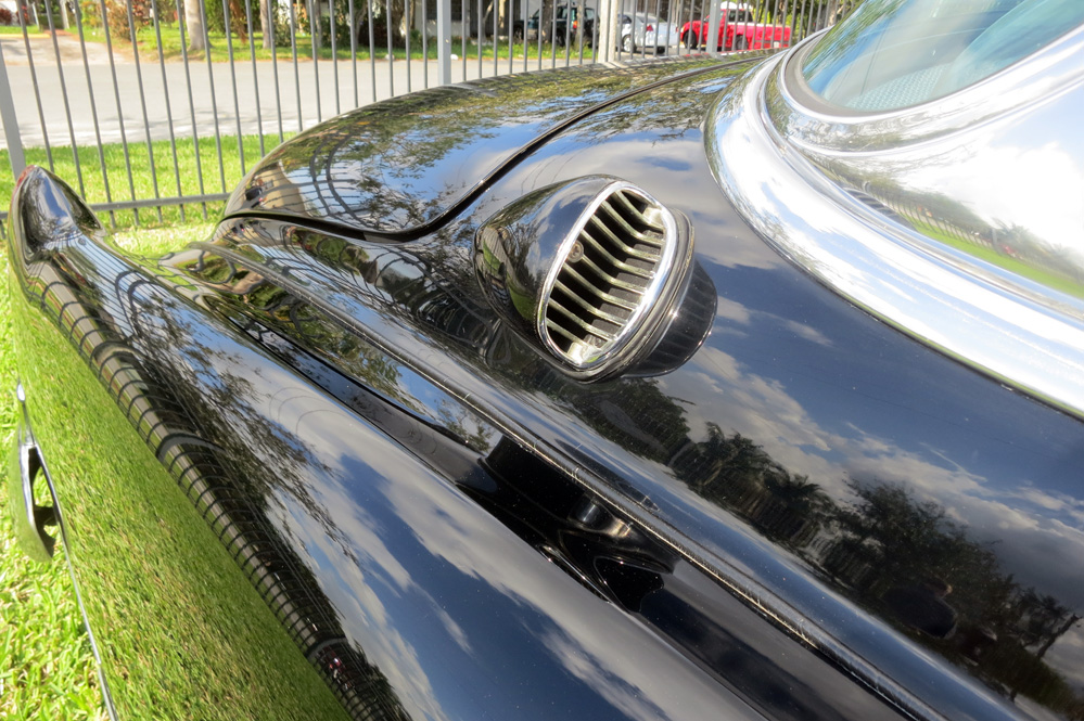Small rear air scoop on Cadillac.