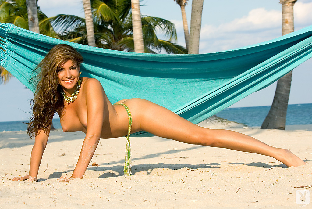 Blonde in a thong bikini on beach