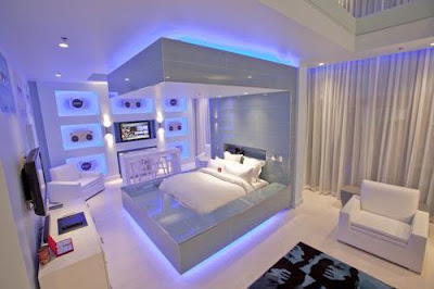 Soft modern bedroom sets with stylish white colors and light blue lighting under bed and overheads