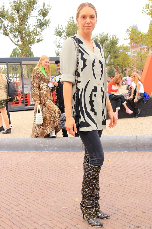 fashion week amsterdam street style fashion of long boots with high heels. dutch woman girl
