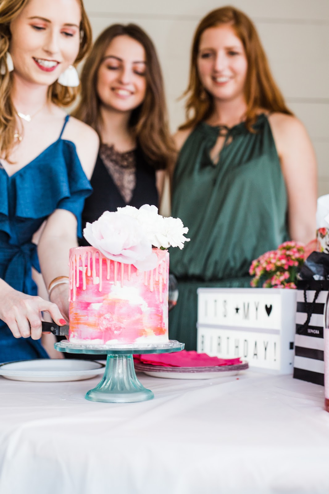 the wandering whisk bakeshop cutting the cake