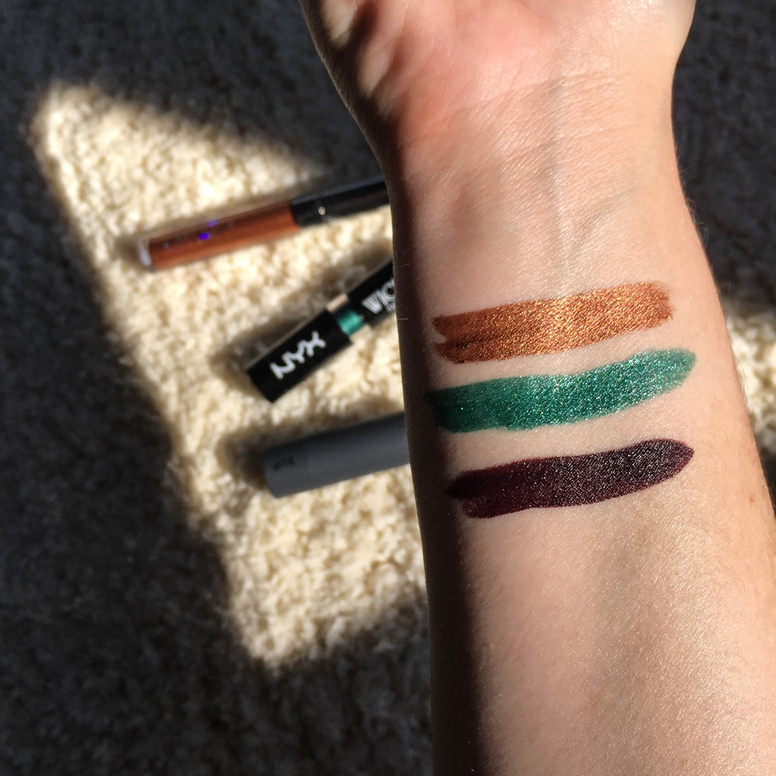 "Swatches of Colourpop Ultra Metallic Lip in ""DM"", Nyx Wicked Lippie in ""Risque"", and Bite Beauty Amuse Bouche Lipstick in ""Black Truffle"""