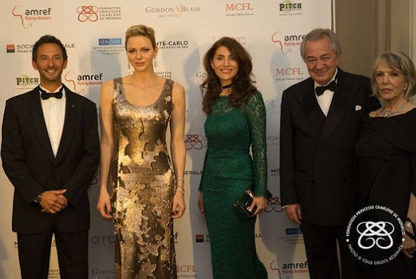 Princess Charlene wore AKRIS Sequined Gown in Gold Metallic at AMREF Gala in evening