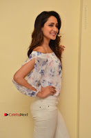Actress Pragya Jaiswal Latest Pos in White Denim Jeans at Nakshatram Movie Teaser Launch  0036.JPG