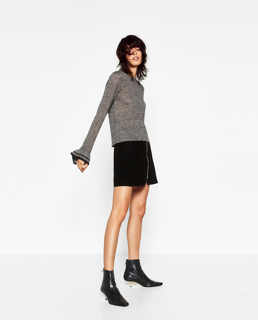 http://www.zara.com/us/en/sale/woman/t-shirts/view-all/sweater-with-sleeve-frill-c732027p4025025.html
