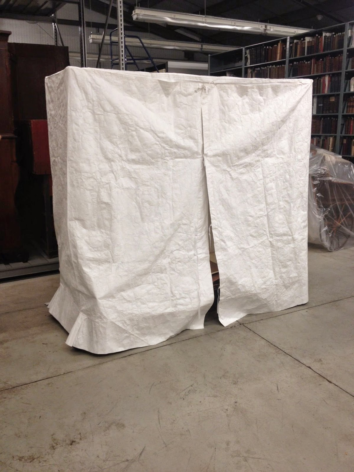 Custom made tyvek dust cover, created and designed by Gwen Spicer of Spicer Art Conservation, New York