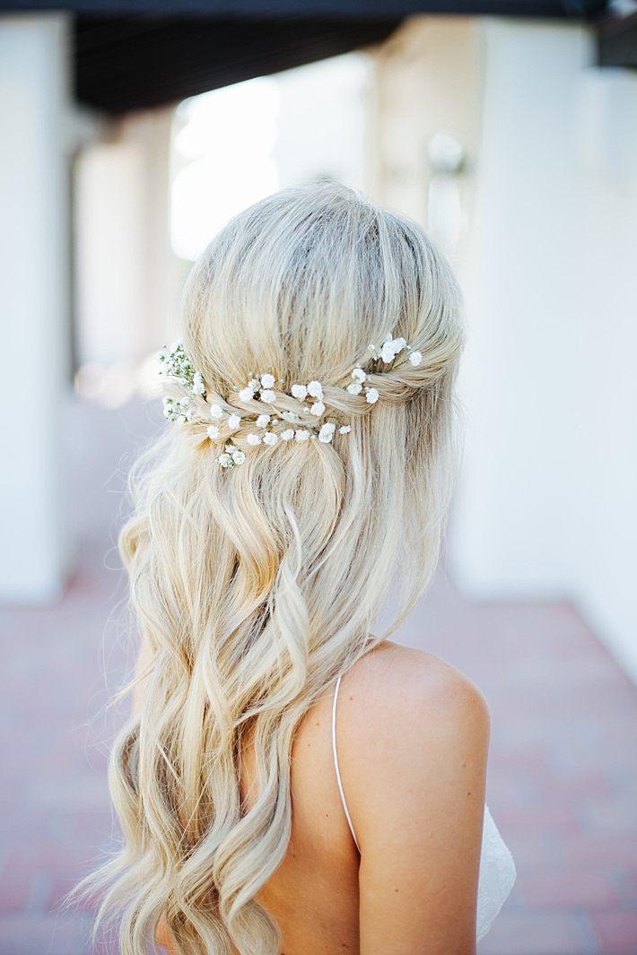 Long Wavy Bridal Hairstyle with flowers | Photography: Photography by Ben and Kadin | Wedding Planner: Jessica Lauren Events