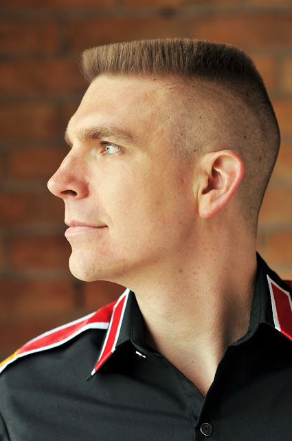 Timothy McGaffin II - Flat Top haircut, side view, profile, head shot, turned head, close up, red, military, collar, highlights, clue eyes, model, GQ, black shirt, buttoned,