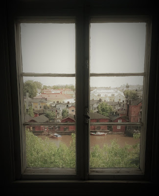 A photo of a town, seen through a window