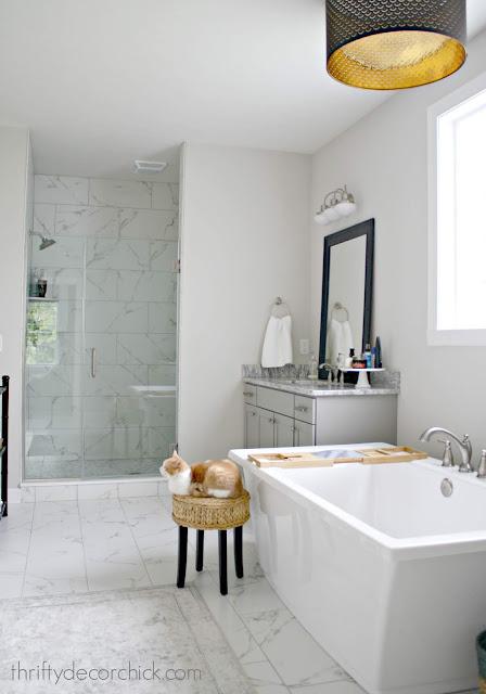 Freestanding soaking tub with separate vanities