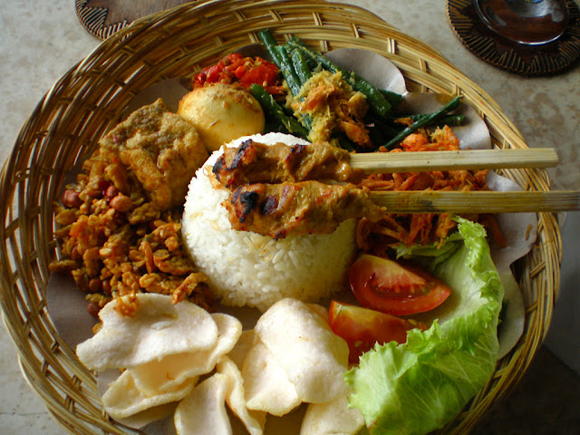 Nasi Campur is a rice dish served with varying side dishes