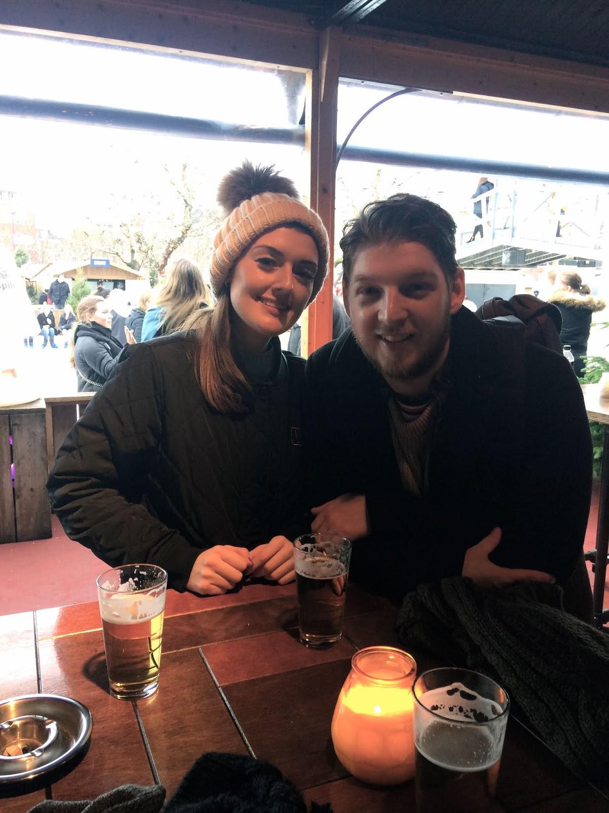 Best friends enjoying a beer in Amsterdam
