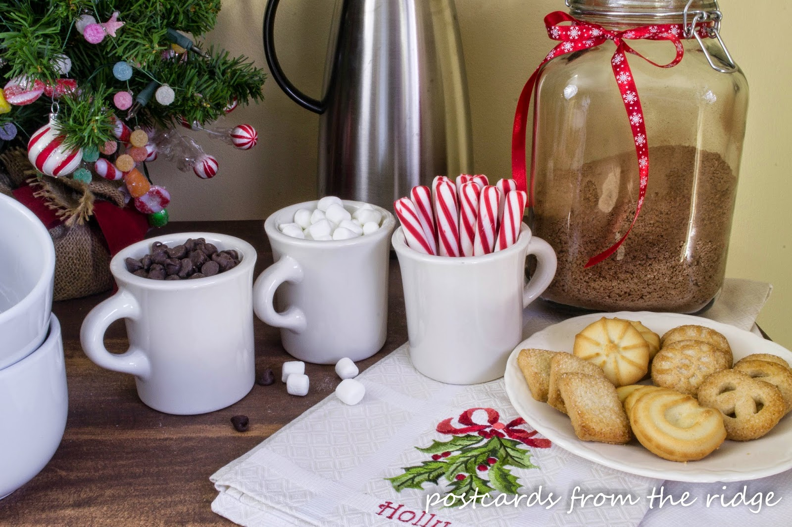 Such a pretty hot cocoa bar using vintage Homer Laughlin mugs for fun additions. Love the embroidered linen too.