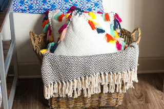 Home decor on a budget. Tassel pillows. Wicker basket. Throw blanket. | texasweettea