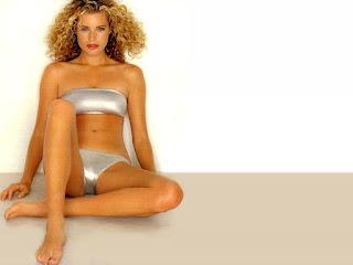 Rebecca Romijn Sitting On The Floor In Bikini