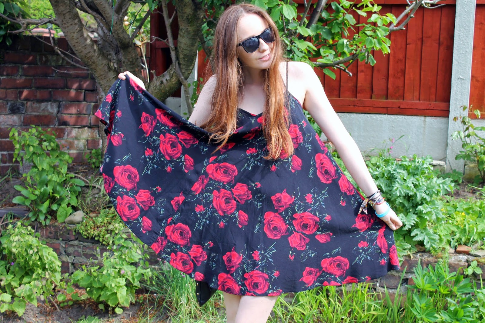 wide full strappy rose print dress, girl twirling in dress, asos floral summer dress, black raybans