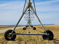 Professional landscape photograph of farm equipment pivot line in Ririe, Idaho by Cramer Imaging