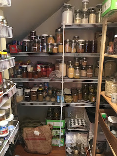 Walk-in pantry with shelves of glass storage jars full of vegan (whole food plant-based) foods https://trimazing.com/