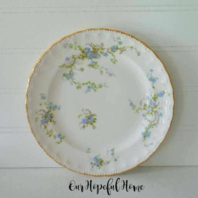 thrifted Popegosser china gilded rim blue floral plate