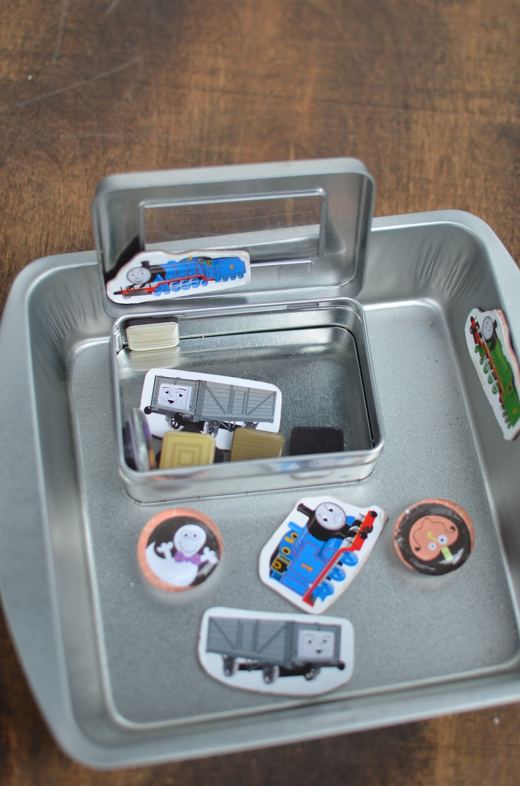 take magnets and a dollar store square pan for a road trip for toddlers.