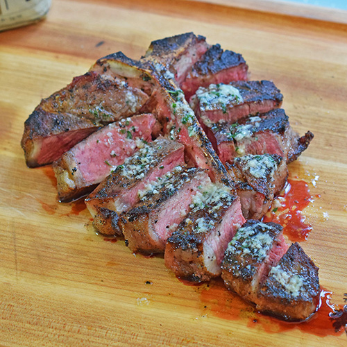 Certified Angus Beef Brand T-Bone Steak with Roasted Garlic Butter featuring the #BestAngusBeef