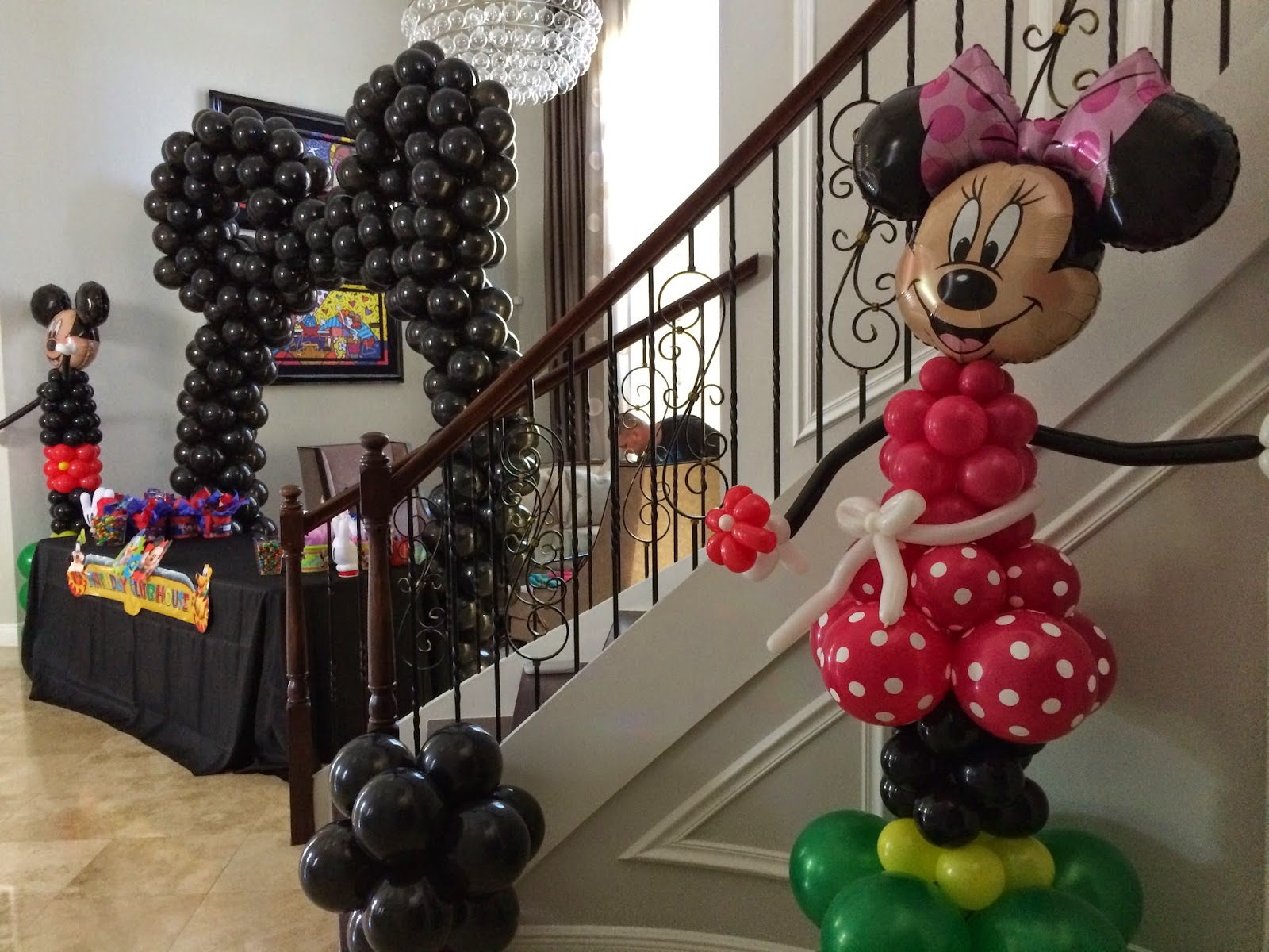 Mickey character, Minnie character, balloon  arch with Mickey ears