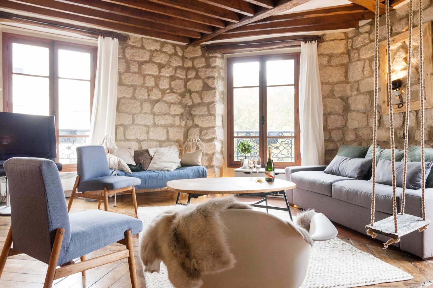 this apartment in the centre of Paris looks more like a castle with the stone walls and the open fireplace, Cal McTravels, www.calmctravels.com
