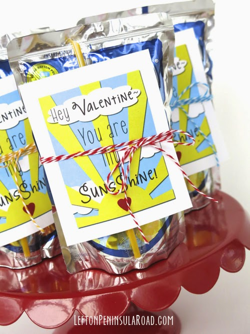 You Are My Sunshine Valentine's Day Cards and Capri-Sun drink pouches wrapped up in baker's twine bows.