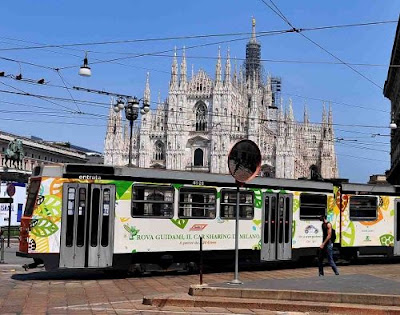 Tram at Piazza del Duomo passing the front of Milan Cathedral
