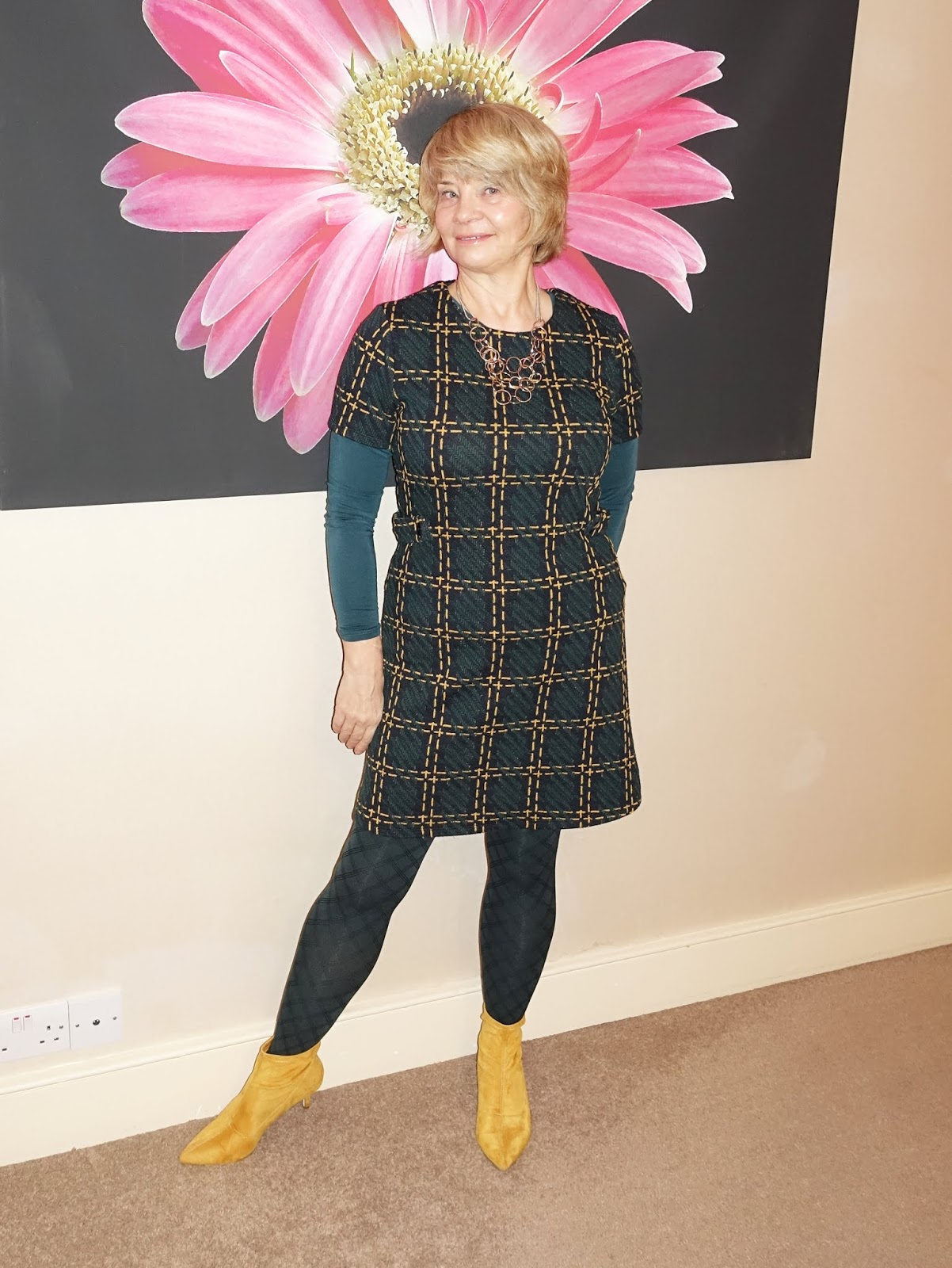 Supermarket chic for work: a tunic dress and mustard boots from Sainsburys worn with teal tights and silky top