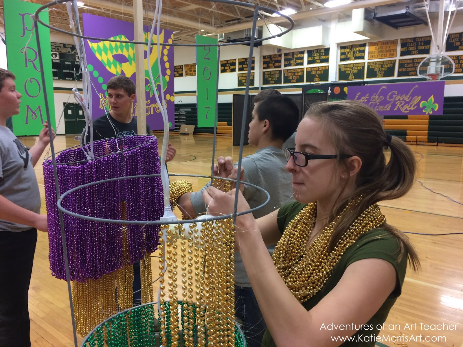 Adventures of an art teacher mardi gras prom we made chandeliers out of tomato cages and a hula hoop for the large one the throw beads were strung with loops of fishing line arubaitofo Choice Image