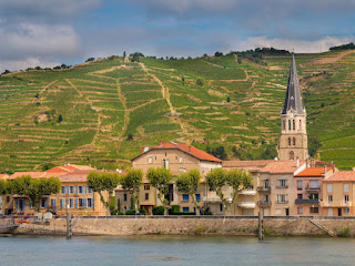 Tournon-sur-Rhône river town and vineyards on the hills in Côtes du Rhône