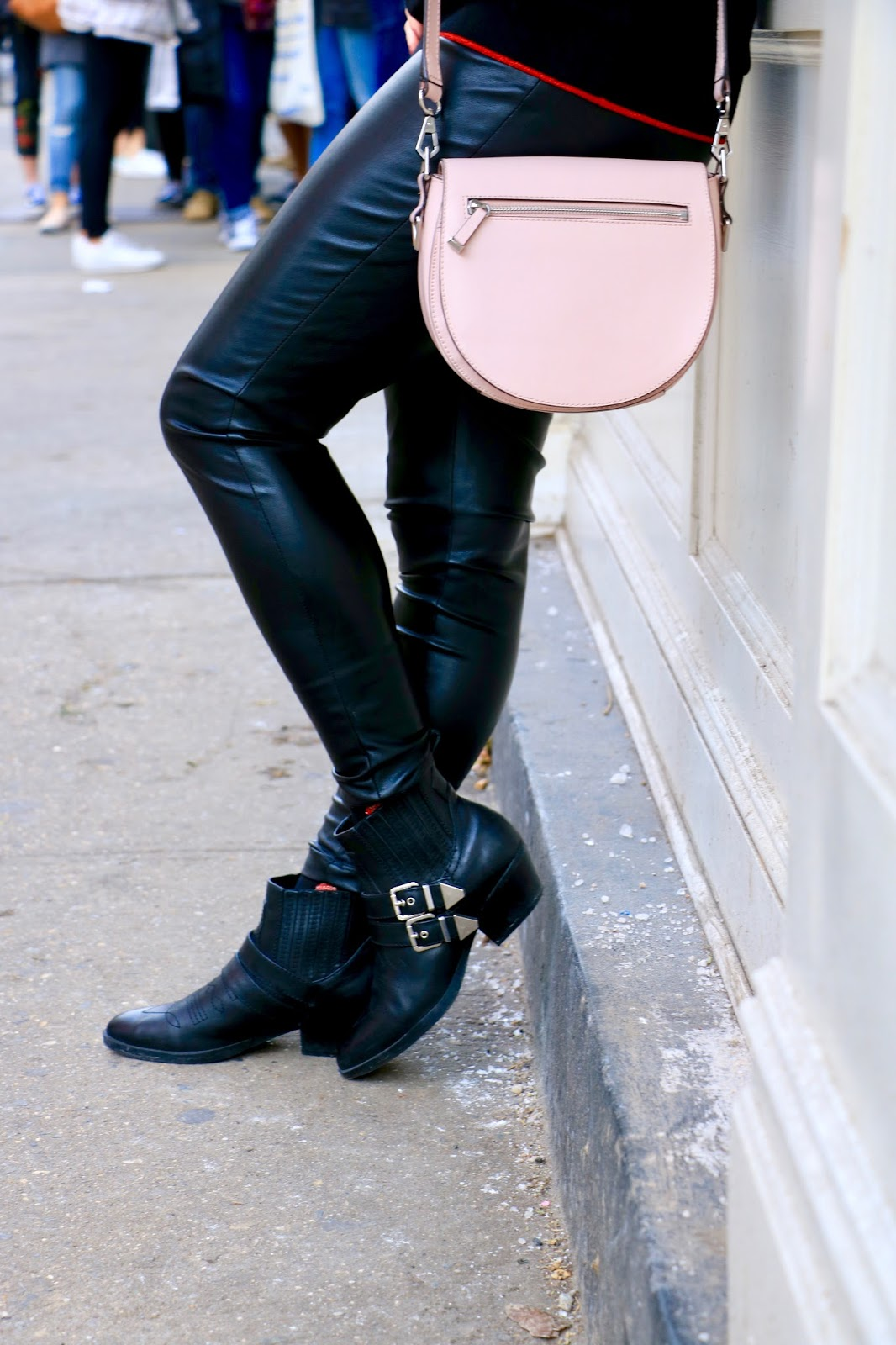 Nyc fashion blogger Kathleen Harper showing how to wear leather leggings